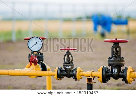 Red Faucets With Steel Pipe In Natural Gas Treatment Plant
