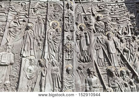 OPOLE POLAND - OCTOBER 07 2016: Bronze door of salvation history and important events in the history of Opole Cathedral Basilica of the Holy Cross. Opole Cathedra was lbuilt in the 15th century the doors were made in the 700th anniversary of the parish