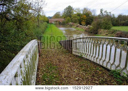 Rural canal tow path on an overcast Autumn day in Warwickshire United Kingdom