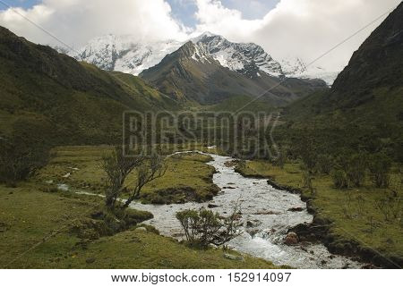 River of melted water of the Tullparahu glacier flowing down the valley of Quillcayhuance, Peru