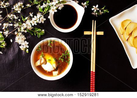 Composition with Japanese miso soup and spring flowers