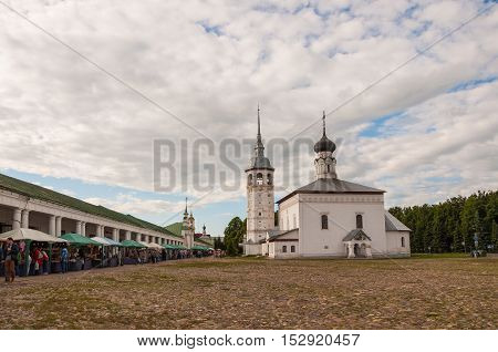 SUZDAL RUSSIA - JUNE 6 2015: Panorama of Church of the Resurrection in Market Place or The Resurrection Church - old church on main square next to the Suzdal shopping arcade built in 1720. Russia