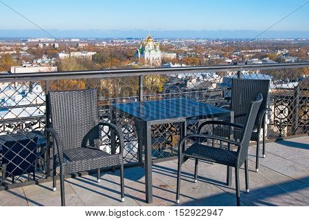 PUSHKIN (TSARSKOYE SELO), SAINT - PETERSBURG, RUSSIA - OCTOBER 19, 2016: The observation deck of The Singers (Pevcheskaya) Water Tower. On the background is Church of St. Catherine Martyr.