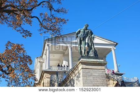 TSARSKOYE SELO, SAINT - PETERSBURG, RUSSIA - OCTOBER 19, 2016: The Cameron Gallery Ensemble (The Cameron Thermae) in The Catherine Park. Hercules Statue. The Tsarskoye Selo is State Museum-Preserve