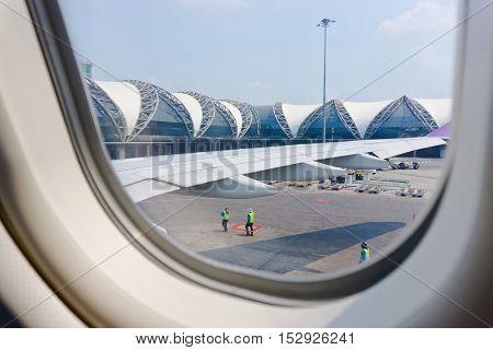 BANGKOK - APRIL 22: Suvarnabhumi Airport is one of two international airports serving Bangkok on April 22 2016 in Bangkok Thailand. View through the window.