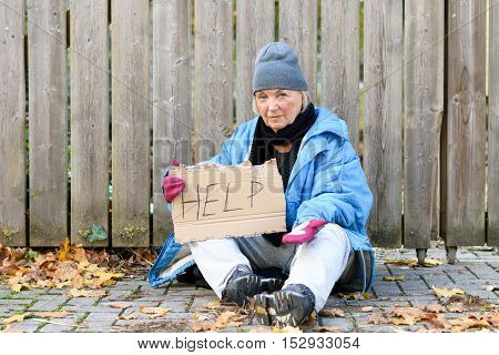 Elderly Homeless Woman Begging On The Street