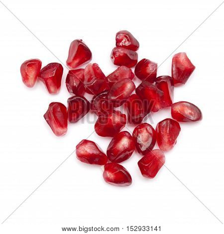 red juicy pomegranate seeds isolated on white background