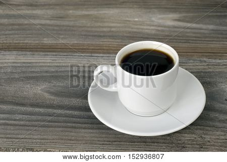 cup of coffee on the old unpainted board