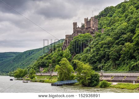 Trechtingshausen Germany - May 23 2016: Rheinstein Castle in cloudy weather on the Rhine Gorge near Trechtingshausen Rhine Valley Rhineland-Palatinate Germany.