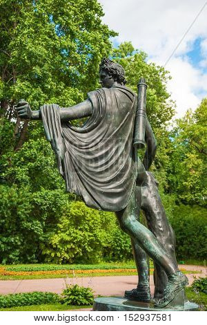 Copper replica of statue of Apollo Belvedere on granite terrace Catherine Park in Tsarskoye Selo. 1854. Workshop of Hamburger. Russia, Saint-Petersburg, Tsarskoye Selo. July 2, 2013