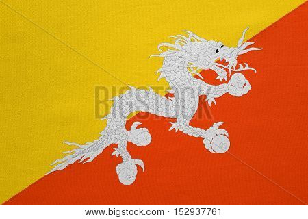 Bhutanese national official flag. Patriotic symbol banner element background. Correct colors. Flag of Bhutan with real detailed fabric texture accurate size illustration