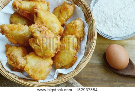 Fried chicken in basket with chicken batter mix and egg