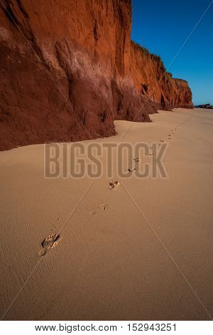 James Price Point, North of Broome in Western Australia. The spring tide had just receded leaving a perfectly untouched beach set off against the red pindan cliffs. Off with the shoes a quick walk along the beach and a detour back out of frame view