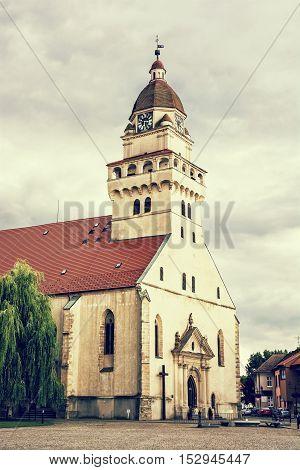 Parish church of saint archangel Michael Skalica Slovak republic. Religious architecture. Travel destination. Cultural heritage. Retro photo filter. Beautiful place.