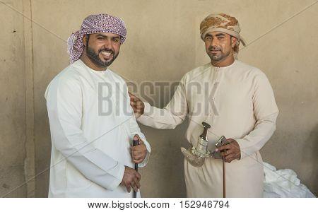 Nizwa Oman October 13th 2016: men at the gun market