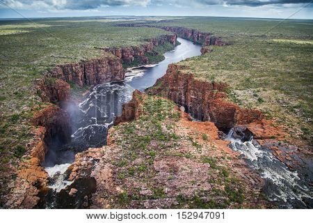 Aerial view from the top of the dual waterfalls on the King George River, Northern Kimberley looking towards the narrow gorge that leads to the open sea.