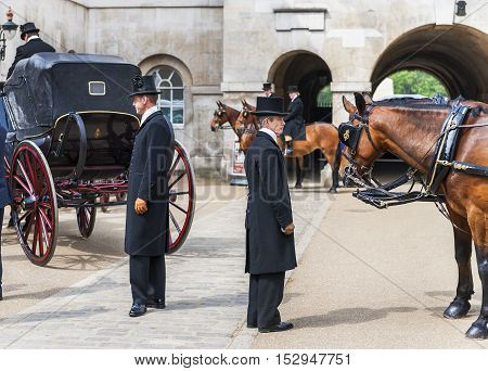 London, the UK - May 2016: Coachmen in the Whitehall yard