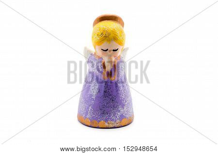 Figurine angel praying for a Christmas tree isolated on white.