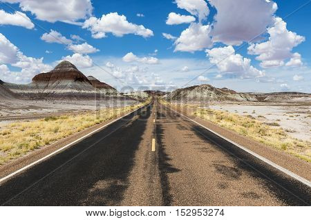 Empty road in the desert in the State of Arizona USA; Concept for road trip and travel in America