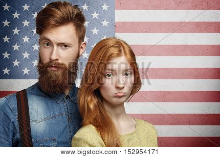 Unhappy Caucasian Family Couple Looking Upset, Having Conflict Or Dispute, Going Through Hard Times.