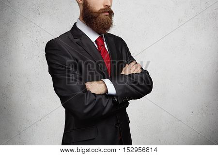 Cropped Shot Of Good-looking Confident And Successful Bearded Entrepreneur Standing With Arms Crosse
