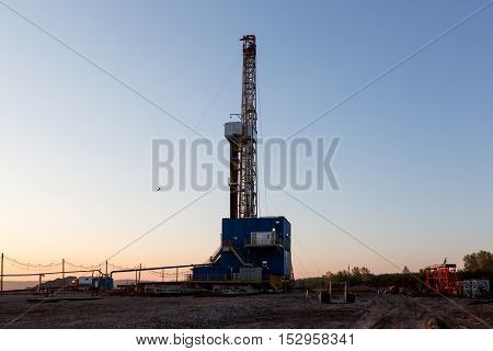 Oil derrick at the sunrise. Tatarstan Russia