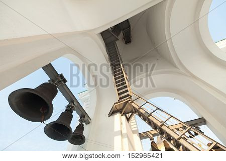 Belltower in church. Type of a bell from below. Belltower of the Russian church.