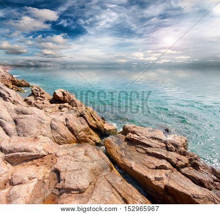 rocky sea coast and the sparkling celestial space