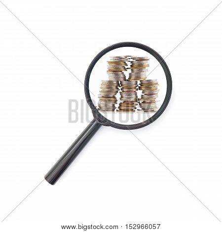 Magnifying glass with Stack of coins money concept of business planning and finance and savings