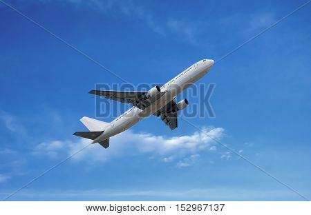 Airplane Under White Cloud On Blue Sky