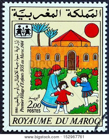 MOROCCO - CIRCA 1985: A stamp printed in Morocco issued for the 1st Moroccan S.O.S. Children's Village shows SOS Children Village, circa 1985.