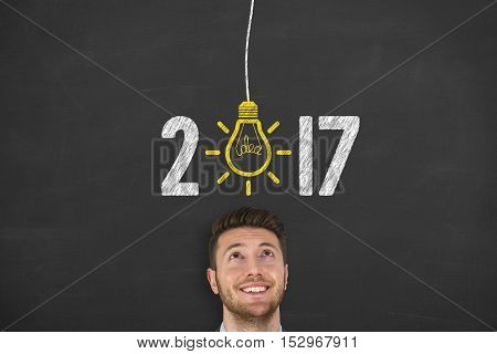 New Year 2017 Idea Concept on Blackboard Background