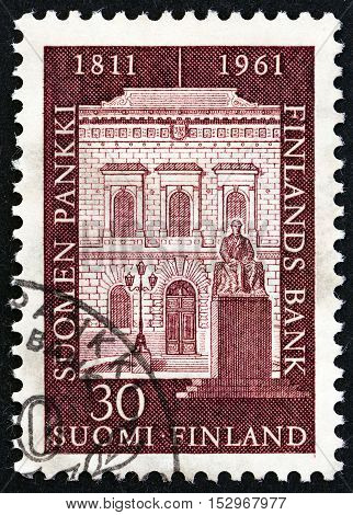 FINLAND - CIRCA 1961: A stamp printed in Finland issued for the 150th anniversary of Bank of Finland shows Bank Facade, circa 1961.