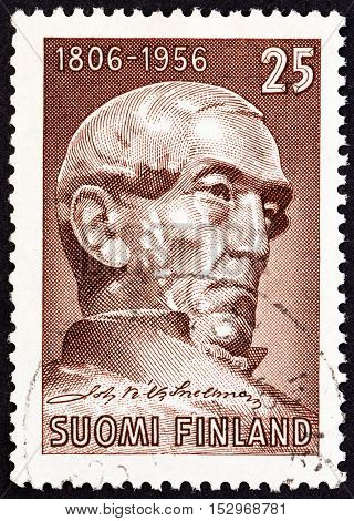 FINLAND - CIRCA 1956: A stamp printed in Finland issued for the 150th anniversary of the birth of Johann Snellman shows Johann V. Snellman (after sculpture by E. Wikstrom), circa 1956.