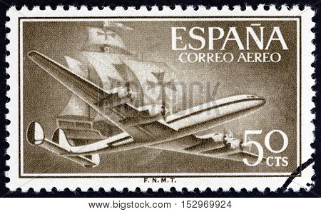SPAIN - CIRCA 1956: A stamp printed in Spain shows Air Lockheed L-1049 Super Constellation aircraft and Caravel, circa 1956.