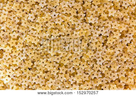 Stelle (Star shaped) pasta texture as background image