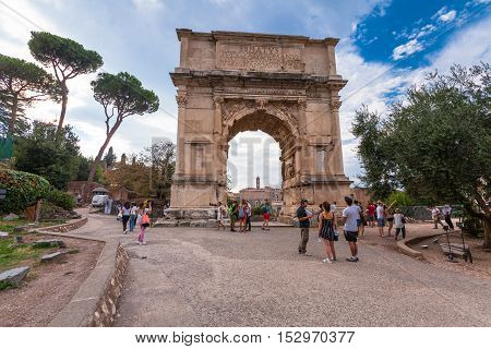 Rome Italy - September 12 2016: Tourists visiting the Arch of Titus (Arco di Tito) in Roman Forum Rome Italy
