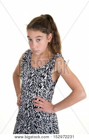 Cheerful Young Girl Posing With Hands On Hip And Looking Down