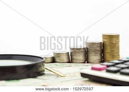 rows of coins on banknote concept finance and banking