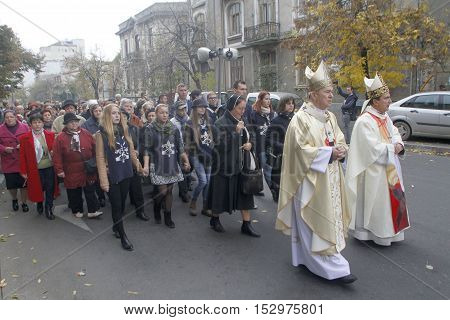 BUCHAREST ROMANIA - OCTOBER 23 2016: Romanian Catholic Metropolitan Archbishop Ioan Robu prays during the Eucharistic procession with the relic of Saint Pope John Paul II.