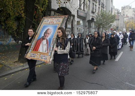 BUCHAREST ROMANIA - OCTOBER 23 2016: The Eucharistic procession with the relic and the icon of Saint Pope John Paul II organized by the Roman Catholic Archdiocese of Bucharest.