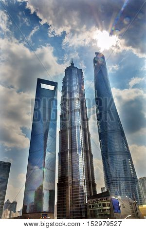 Three Skyscrapers Sun Flare Rainbow Reflections Make Patterns and Designs Liujiashui Financial District Shanghai China. Shanghai Tower Shanghai World Financial Center and Jin Mao Tower