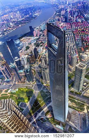 SHANGHAI, CHINA - SEPTEMBER 23, 2016 Looking Down on Black Shanghai World Financial Center Skyscraper Reflections Huangpu River Cityscape Liujiashui Financial District Shanghai China.