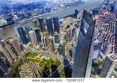 SHANGHAI, CHINA - SEPTEMBER 23, 2016 Looking Down on Black Shanghai World Financial Center SkyscraperJin Mao Tower Huangpu River Cityscape Liujiashui Financial District Shanghai China.