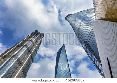 SHANGHAI, CHINA - SEPTEMBER 23, 2016 Three Skyscrapers Reflections Make Patterns and Designs Liujiashui Financial District Shanghai China. Shanghai Tower Shanghai World Financial Center and Jin Mao Tower