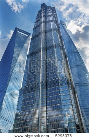 SHANGHAI, CHINA - SEPTEMBER 23, 2016 Jin Mao Tower Three Skyscrapers Reflections Make Patterns and Designs Liujiashui Financial District Shanghai China. Shanghai Tower andShanghai World Financial Center