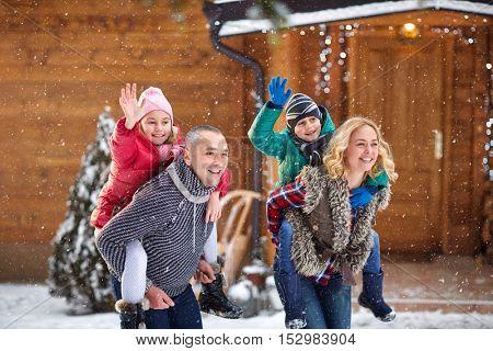 Beautiful smiling family enjoying on winter holiday