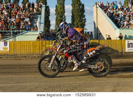 Rivne Ukraine - 29 August 2015: Unknown riders prepares for the start at the Open Cup Speedway to the day of the city Rivne