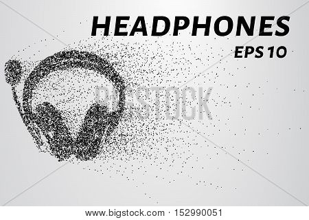 Headphones from particles. Headphones consist of circles and dots. Headphones crumble into small pieces.