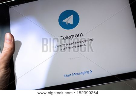 Moscow Russia - October 23 2016: Telegram application on iPad display. Telegram is a cloud-based instant messaging service